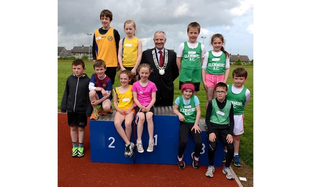 Oliver Tully, Chairperson of Louth County Council, with some athletes at County Athletics Finals (Drogheda, June 2014)